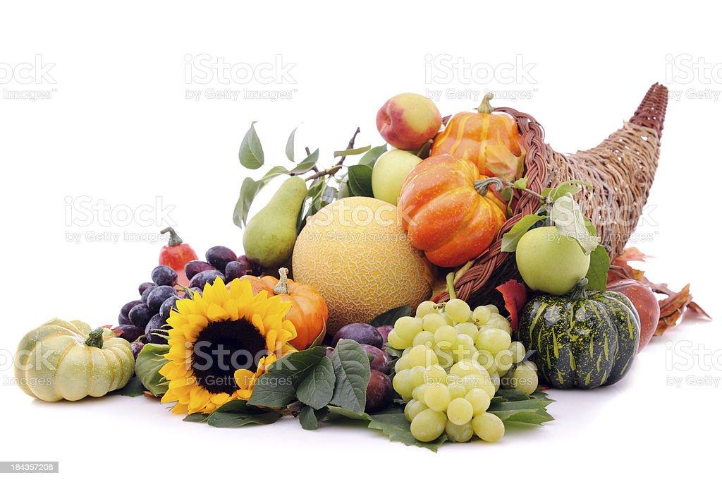 Cornucopia with pumpkins and fruits stock photo