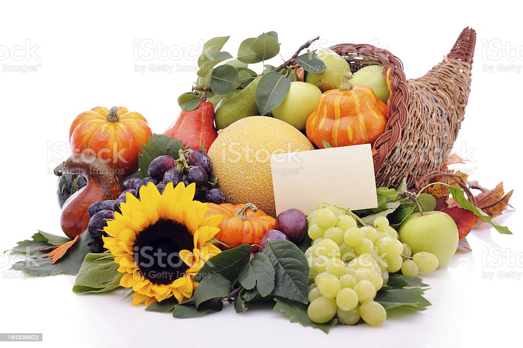 Cornucopia with pumpkins, fruits and an empty card royalty-free stock photo