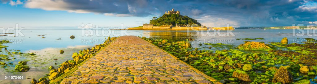 Cornwall golden sunlight on beach causeway to St Michaels Mount stock photo