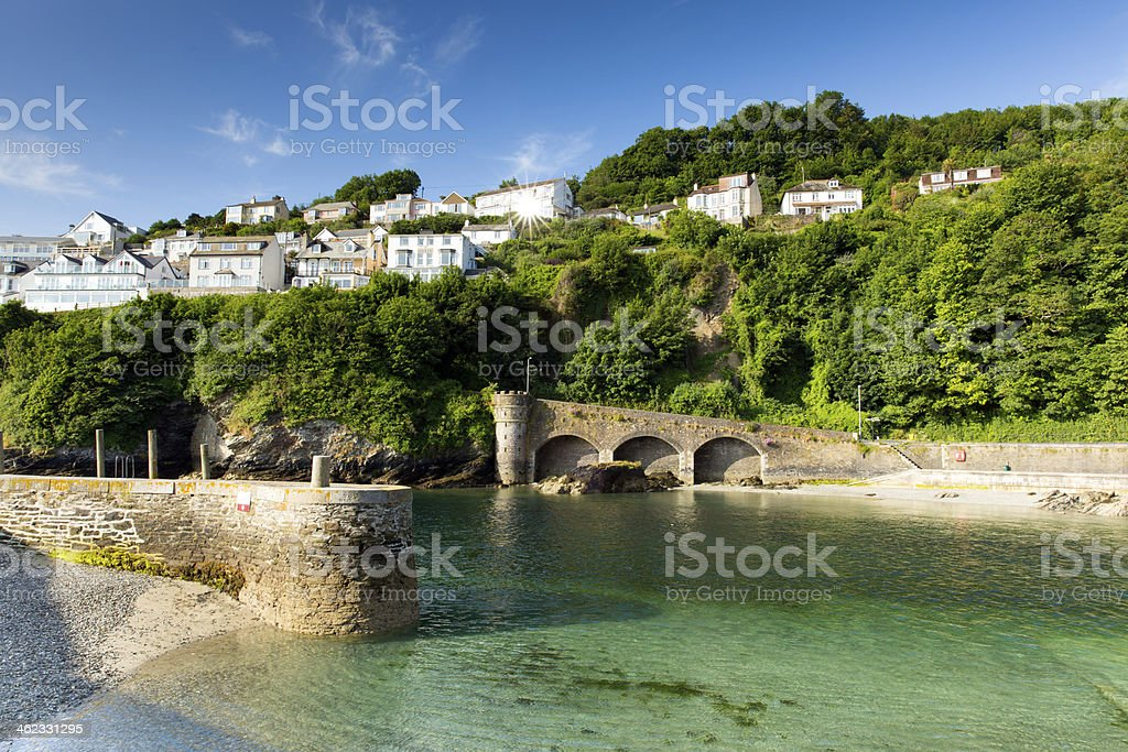 Cornwall harbour wall Looe England UK with clear turquoise sea stock photo