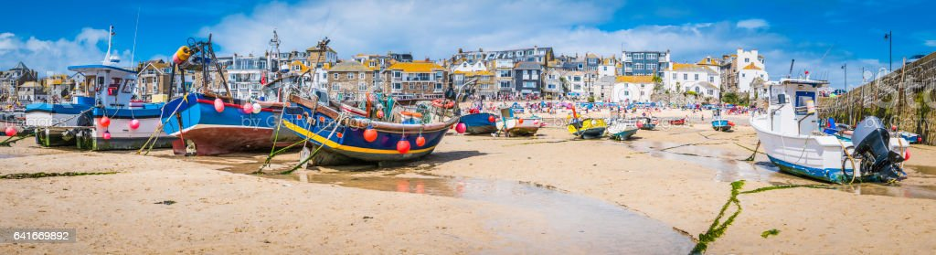Cornwall St Ives fishing boats and tourists beach harbour panorama stock photo