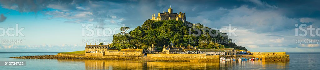 Cornwall St Michaels Mount panorama illuminated by golden sunrise light stock photo