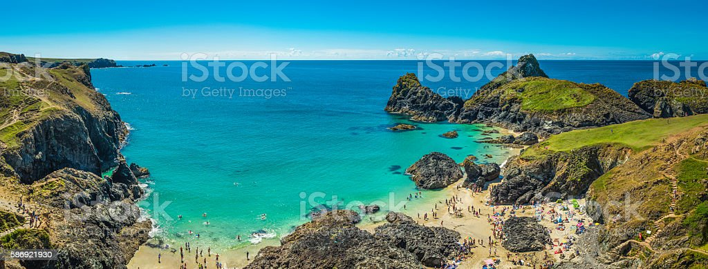 Cornwall tourists enjoying beach blue ocean Kynance Cove panorama UK stock photo