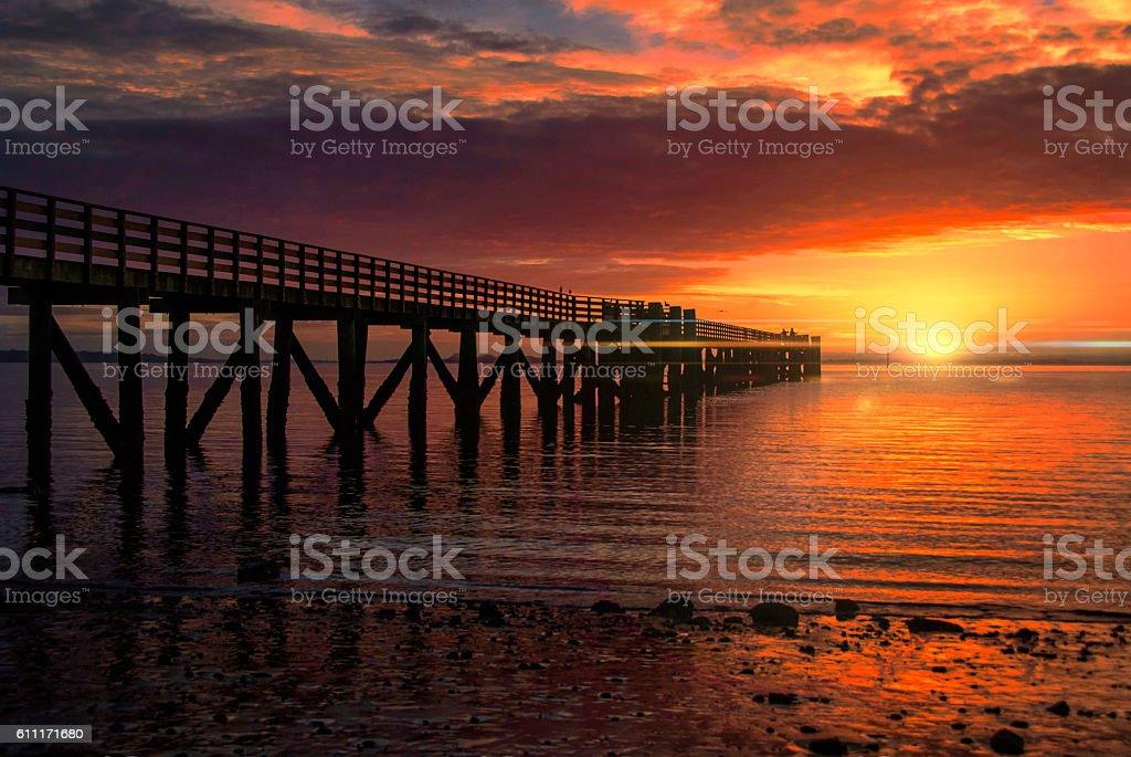 Cornwallis sunrise with flare stock photo