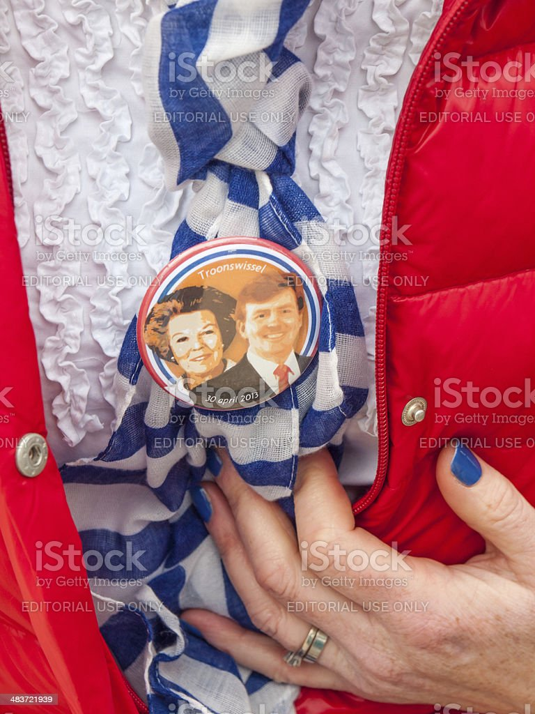 coronation badge womans hand on dutch kings day stock photo