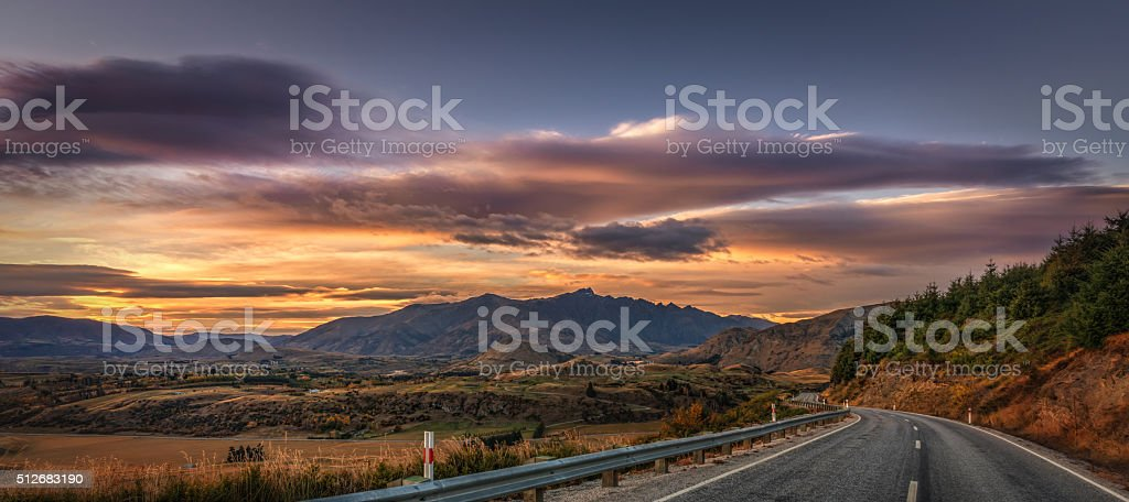Coronet Peak Road On A Colourful Sunrise With Remarkables Ahead stock photo