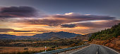 Coronet Peak Road On A Colourful Sunrise With Remarkables Ahead