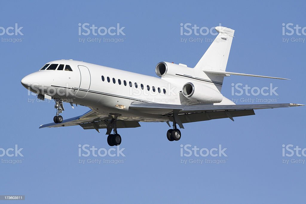 Corporate aircraft flying in a clear blue sky stock photo