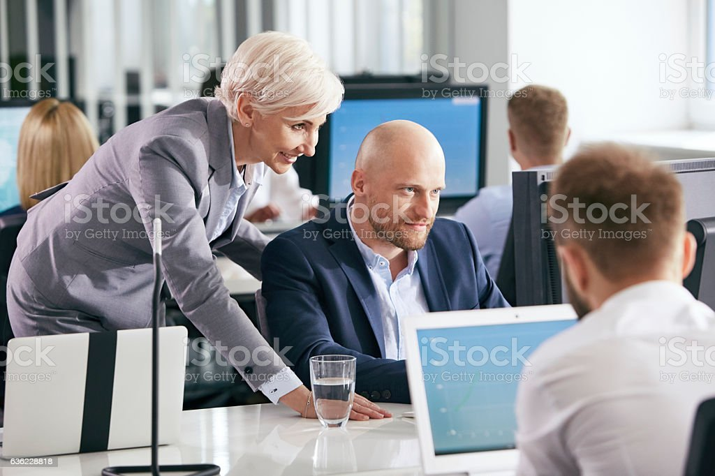 Corporate business. Colleagues at the office stock photo
