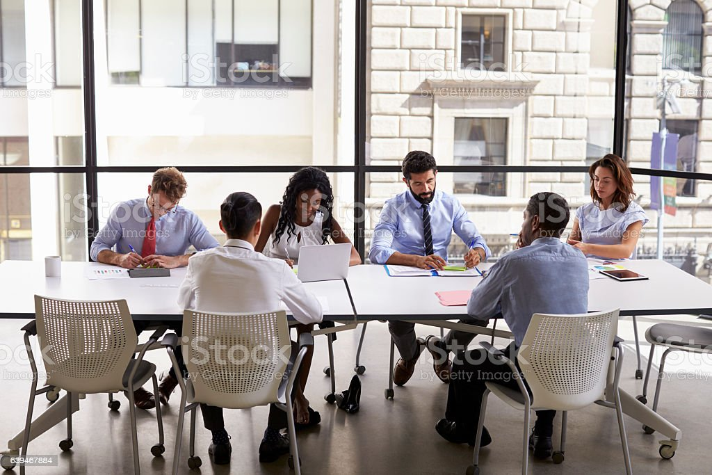 Corporate business team working in a modern open plan office stock photo