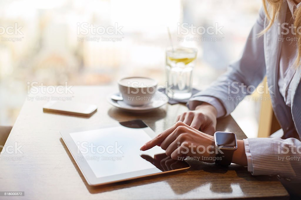 Corporate business woman working on tablet at cafe stock photo