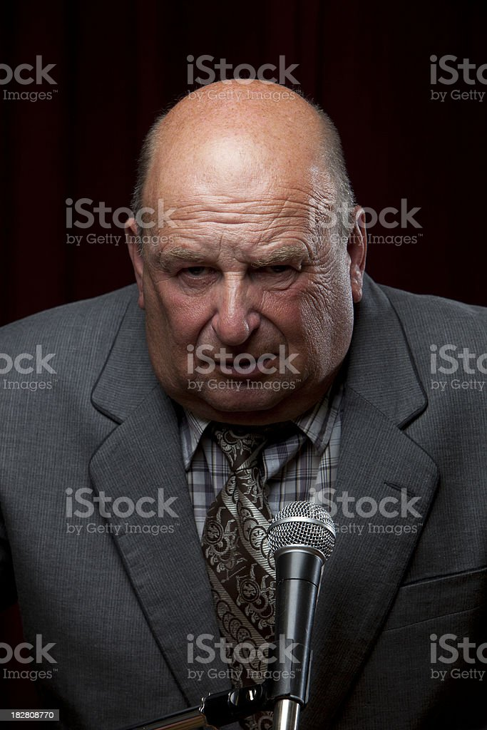 Corporate Businessman at Microphone stock photo