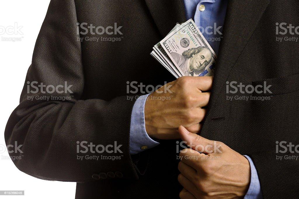 Corporate Businessman Slipping U.S. dollars Money into Suite Pocket stock photo