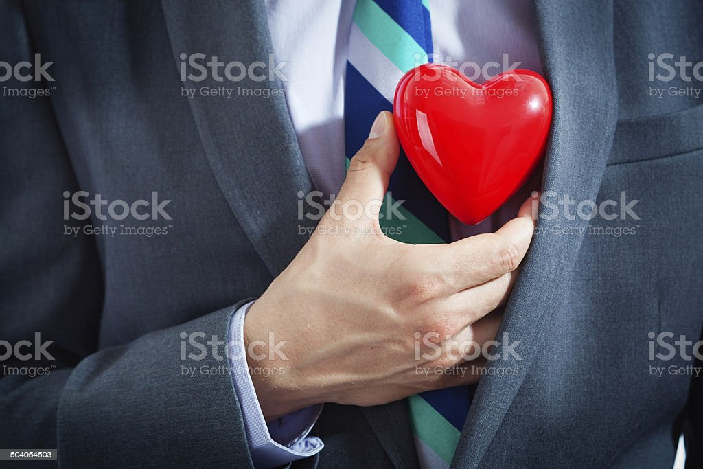 Corporate Businessman with a Heart stock photo