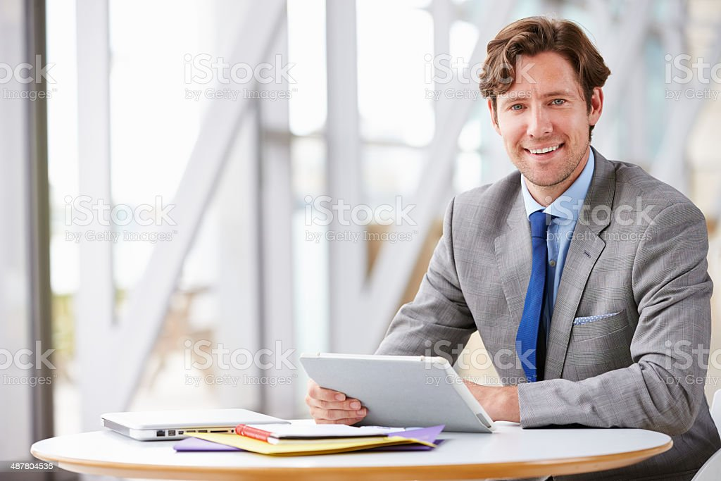 Corporate businessman working with tablet computer stock photo