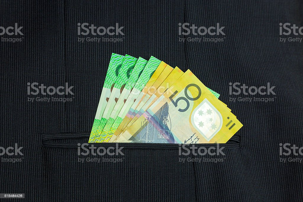 Corporate Cash: big dollar notes in pin-stripe suit pocket stock photo