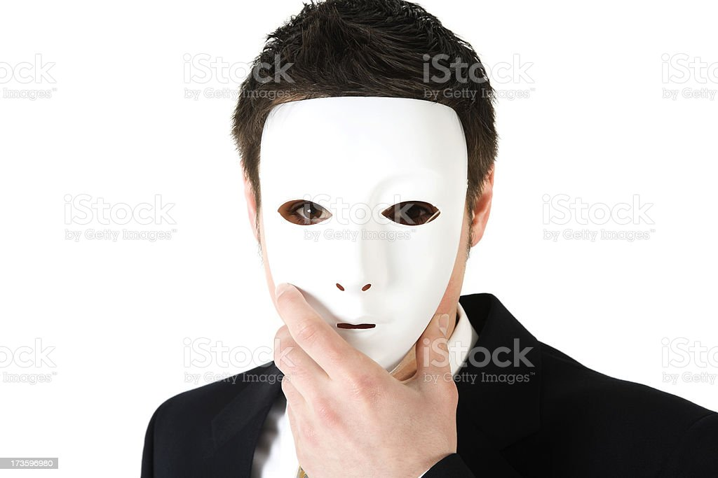 Corporate crime Business man wearing a face mask suit isolated stock photo