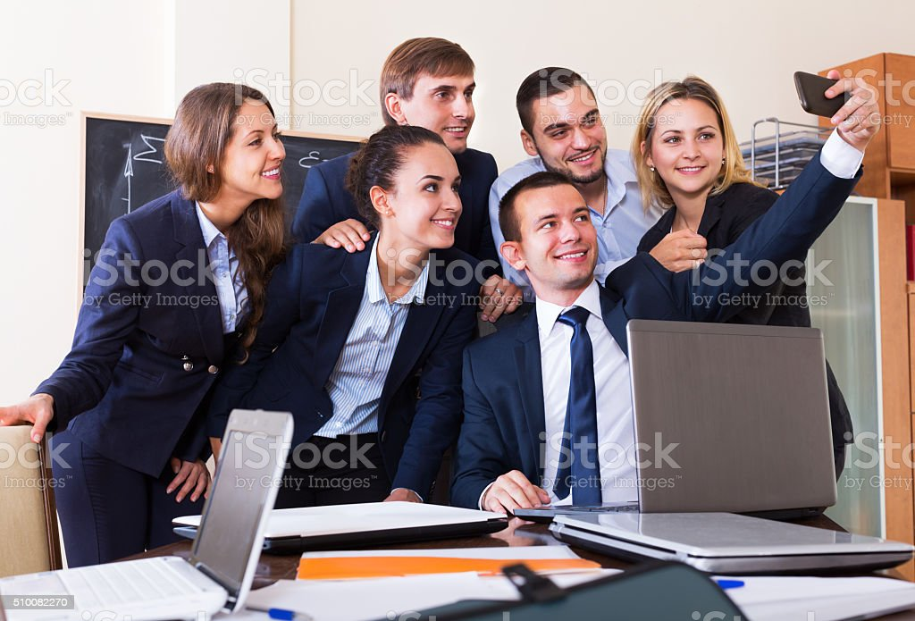 Corporate employees photoshooting together stock photo