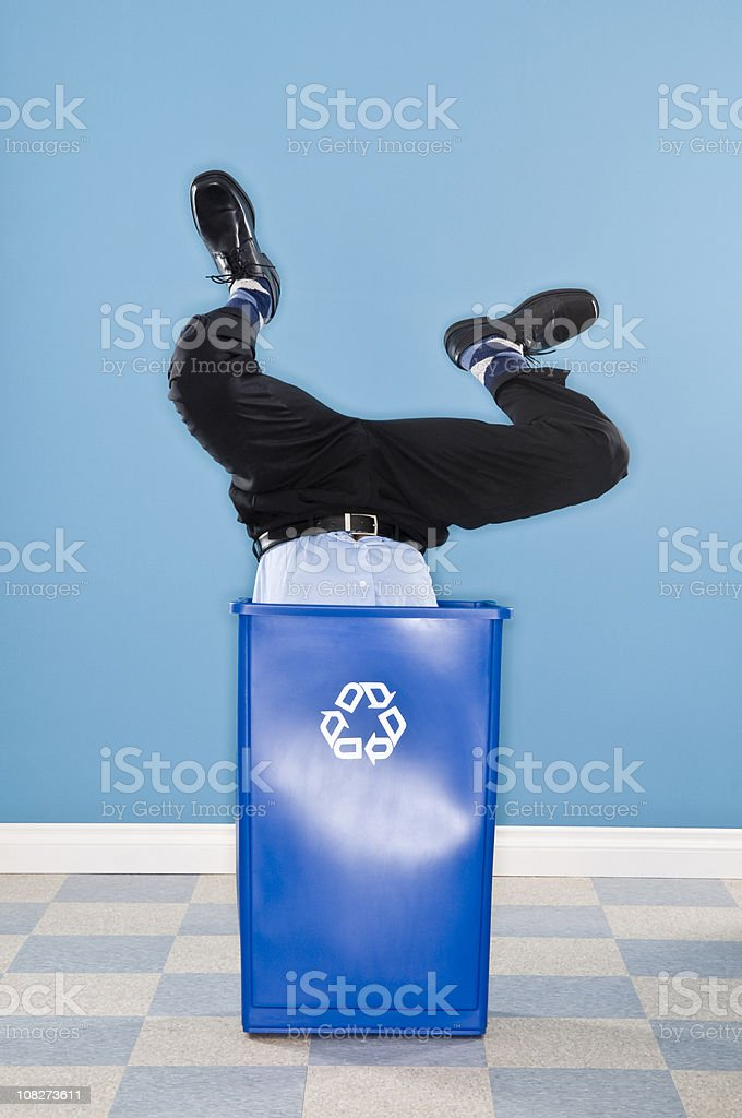 Corporate Executive Discarded in Recycling Container. royalty-free stock photo