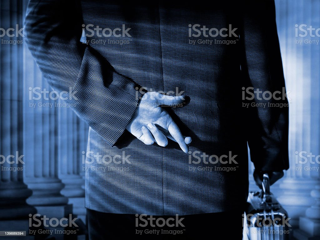 corporate fingers crossed royalty-free stock photo