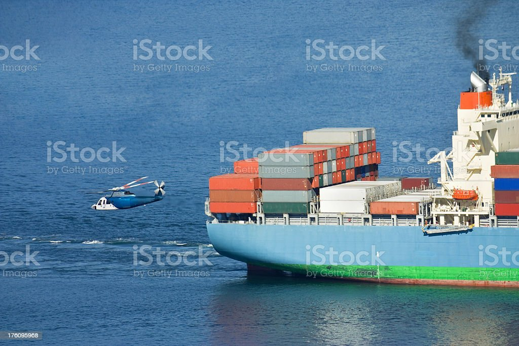 Corporate Helicopter and Cargo Ship stock photo