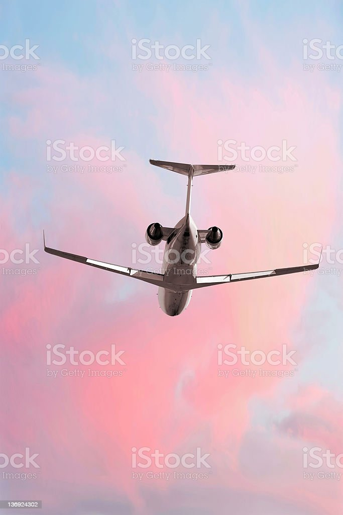 XXL corporate jet airplane flying at dusk royalty-free stock photo