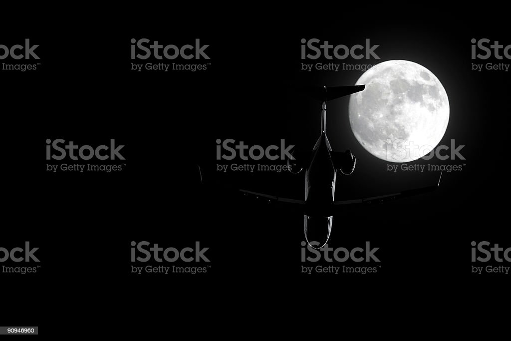 corporate jet airplane flying at night royalty-free stock photo