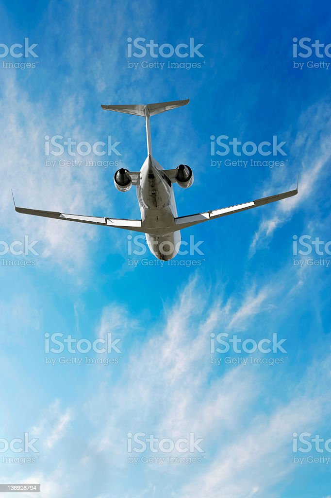 XXL corporate jet airplane flying in bright sky royalty-free stock photo