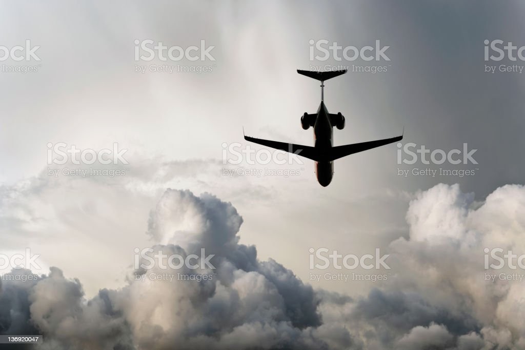 XXL corporate jet airplane flying in storm stock photo