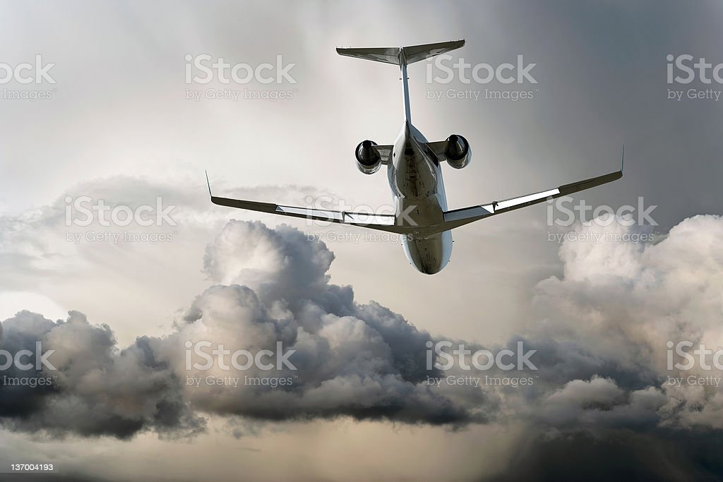 corporate jet airplane flying in storm royalty-free stock photo