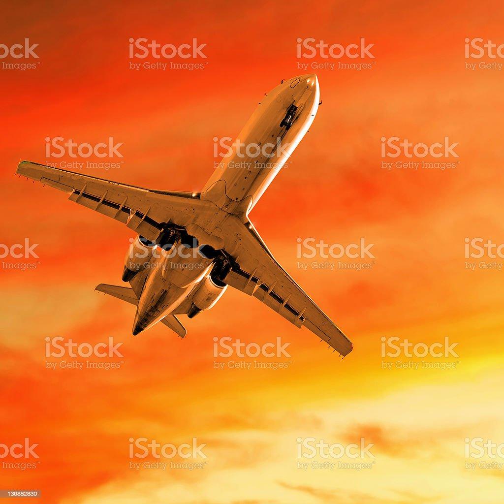 corporate jet airplane landing at dusk stock photo