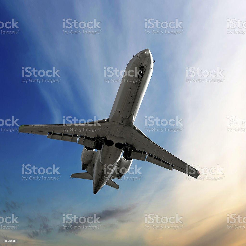 corporate jet airplane landing at dusk royalty-free stock photo