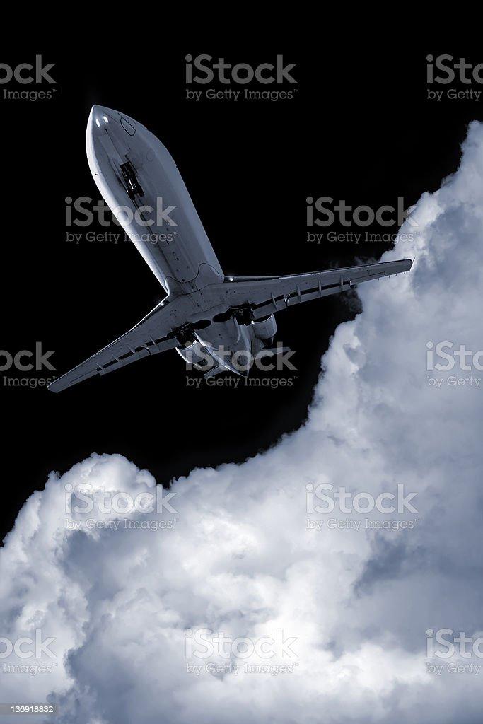 corporate jet airplane landing at night royalty-free stock photo