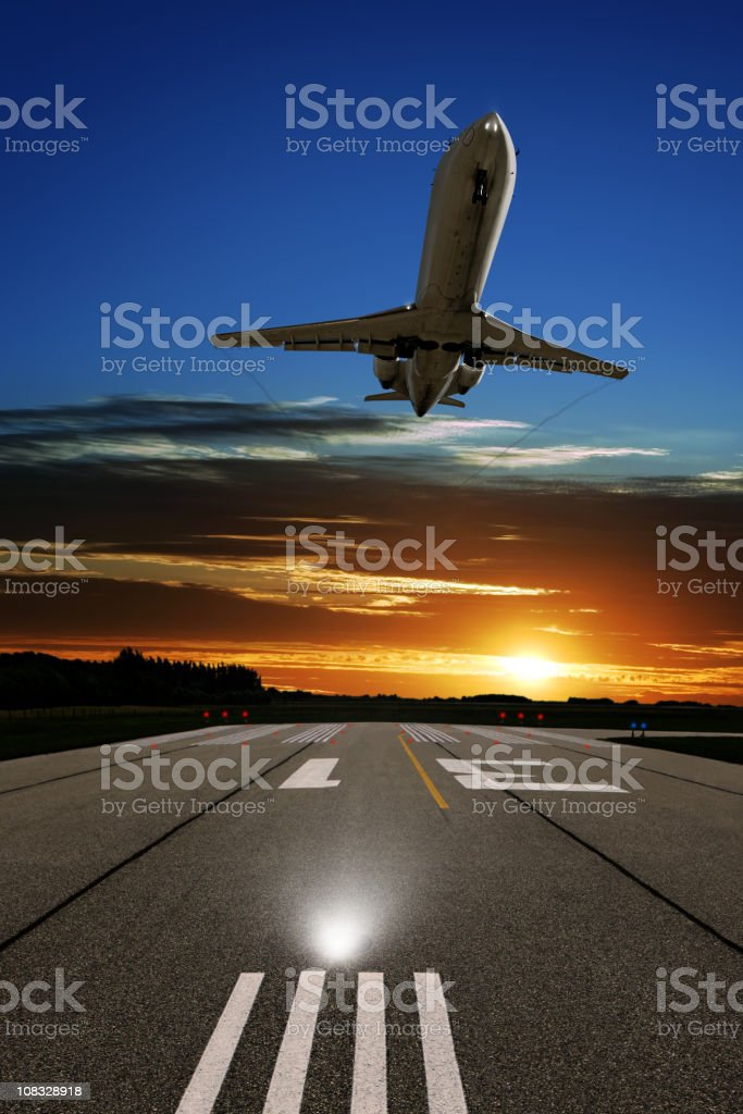 XL corporate jet airplane landing at sunset royalty-free stock photo