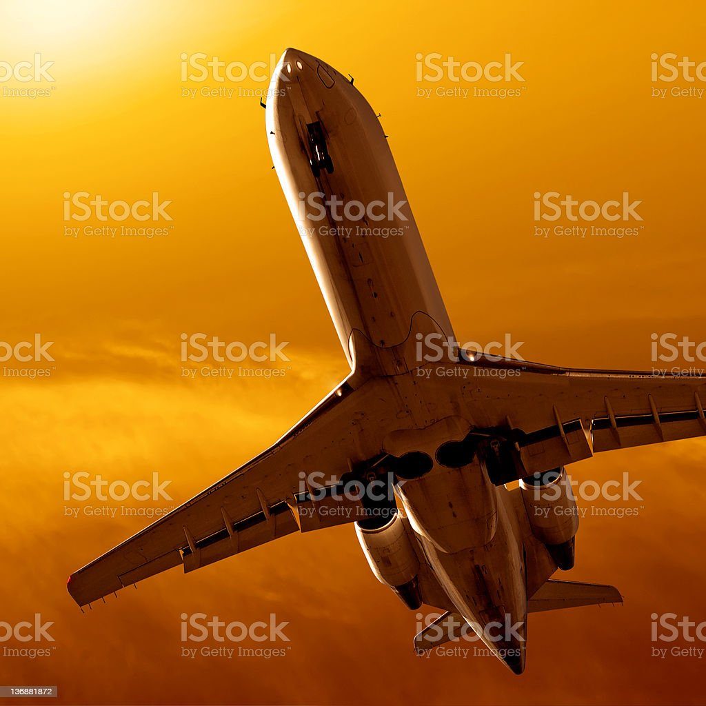 corporate jet airplane landing at sunset royalty-free stock photo