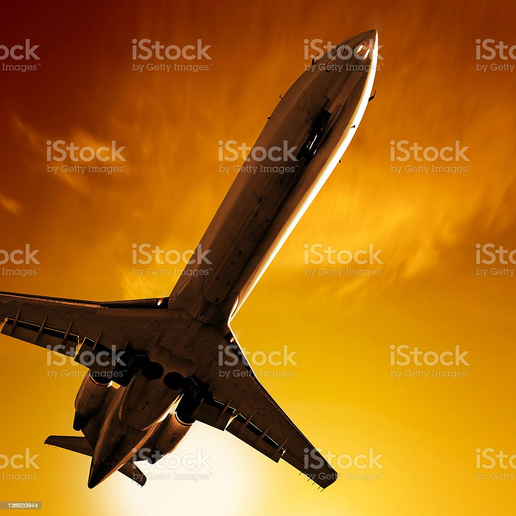 corporate jet airplane landing at sunset royalty-free stock photo