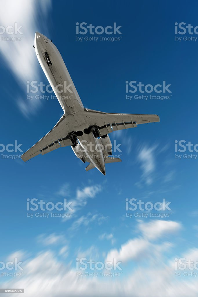 XL corporate jet airplane landing in motion blur sky royalty-free stock photo