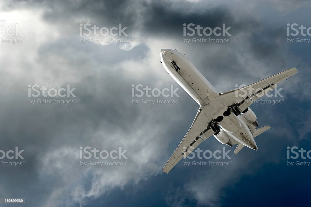 corporate jet airplane landing in storm stock photo