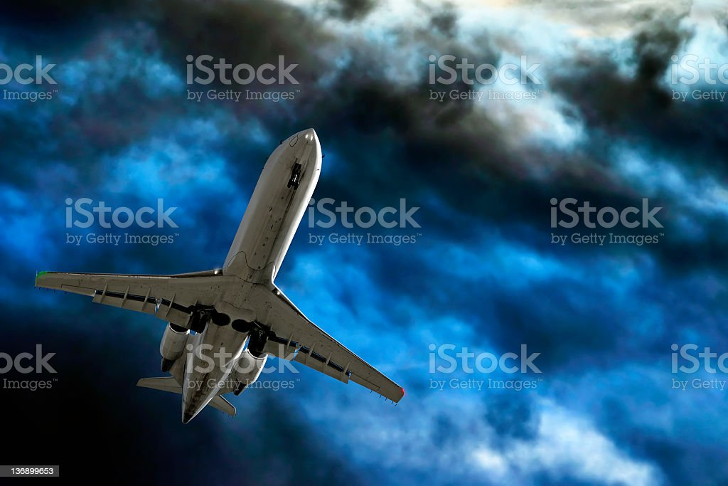 corporate jet airplane landing in storm royalty-free stock photo