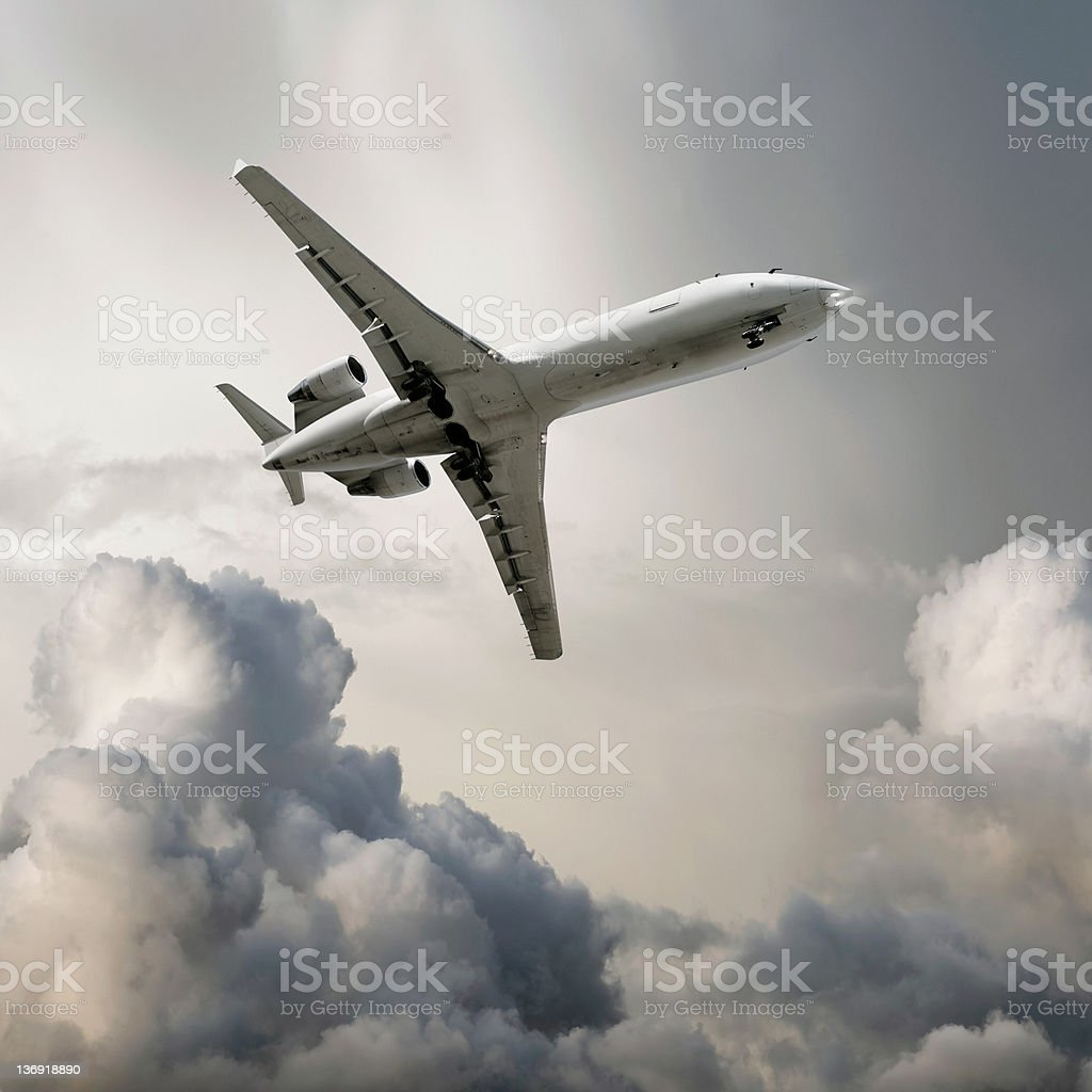 XL corporate jet airplane landing in storm stock photo