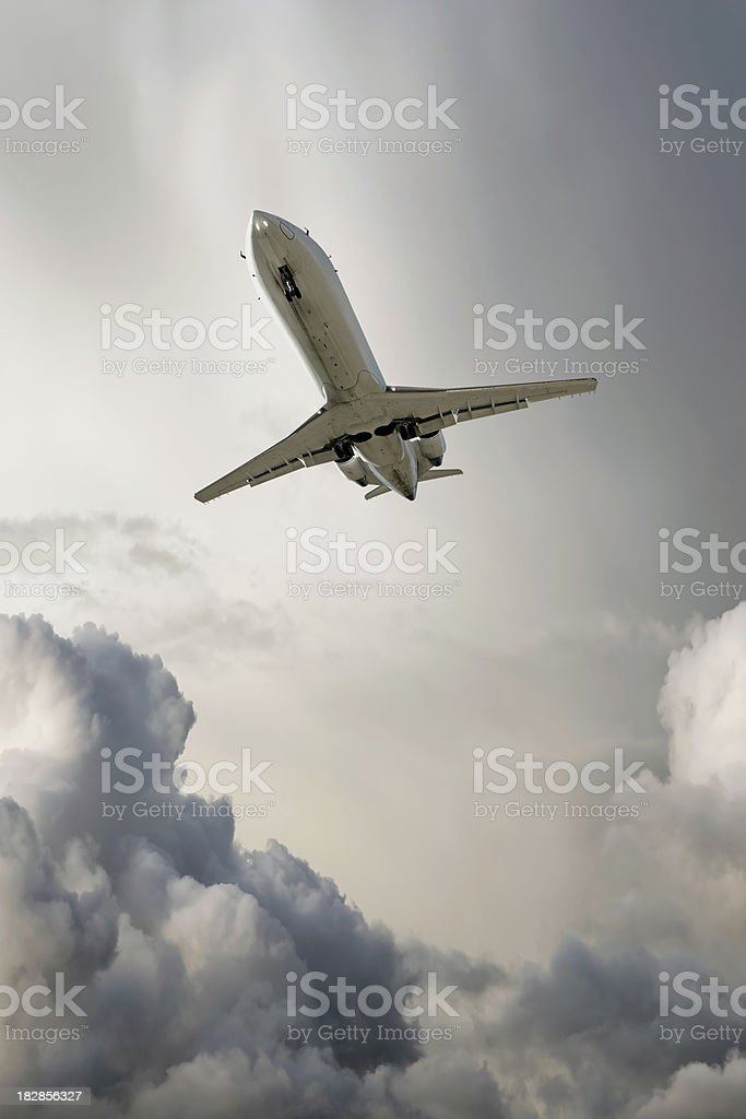XL corporate jet airplane landing in storm royalty-free stock photo