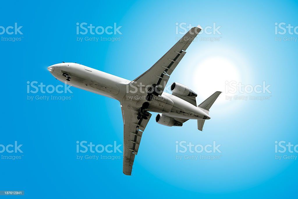XXL corporate jet airplane landing in sunny sky royalty-free stock photo
