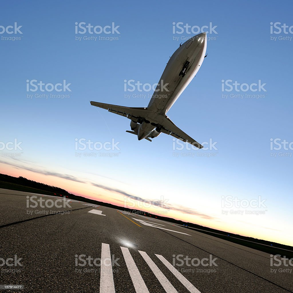 XL corporate jet airplane landing stock photo