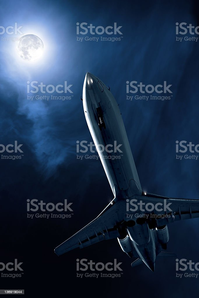 corporate jet airplane taking off at night royalty-free stock photo
