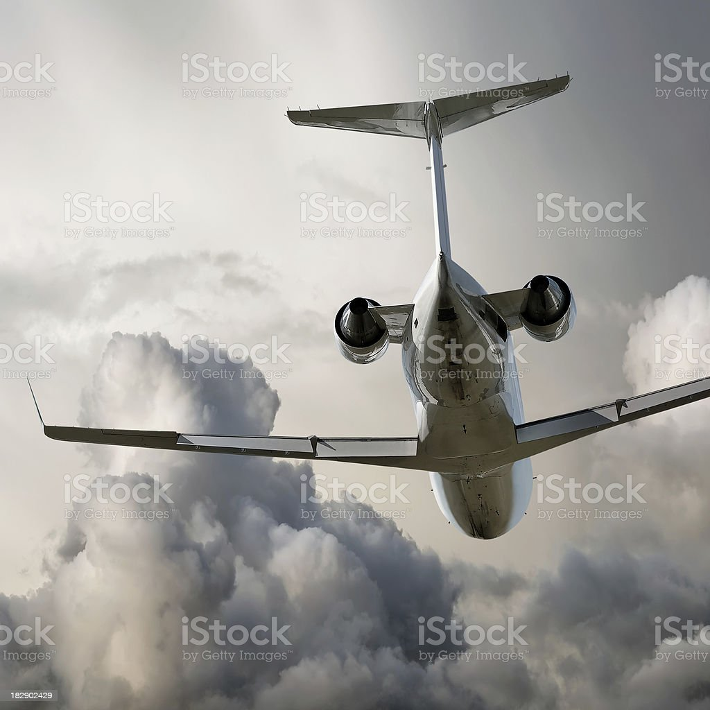 corporate jet airplane taking off in storm stock photo