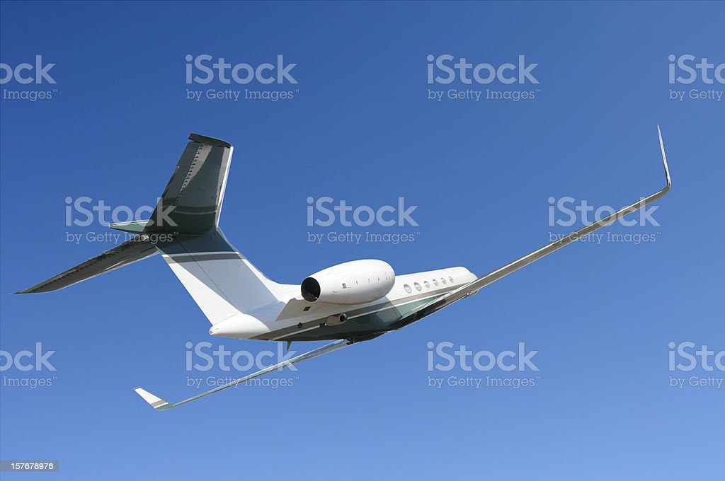 Corporate jet banking against blue sky royalty-free stock photo