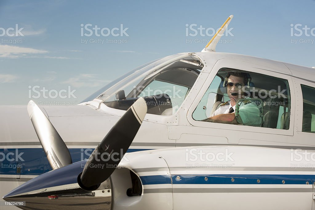 Corporate Jet pilot flying private plane royalty-free stock photo