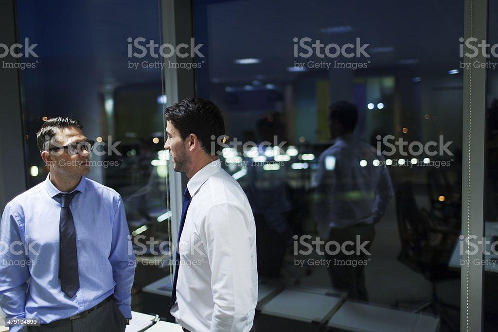 Corporate late night business meeting. stock photo