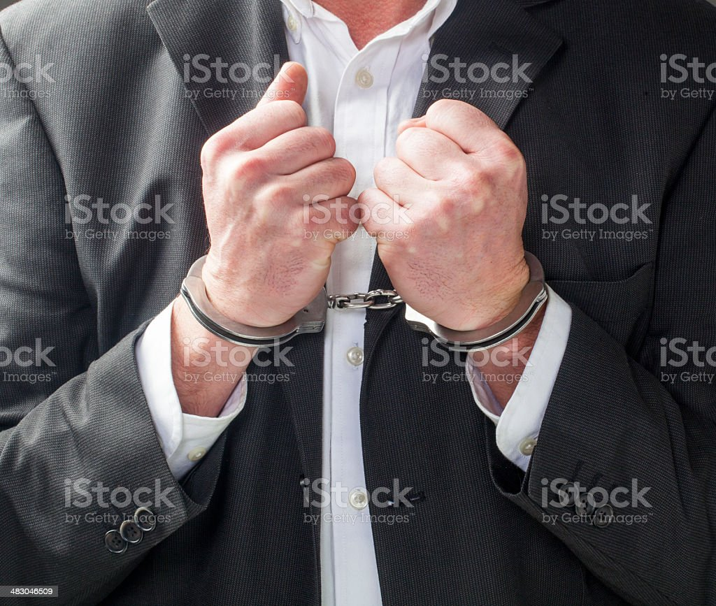 corporate man going to prison royalty-free stock photo