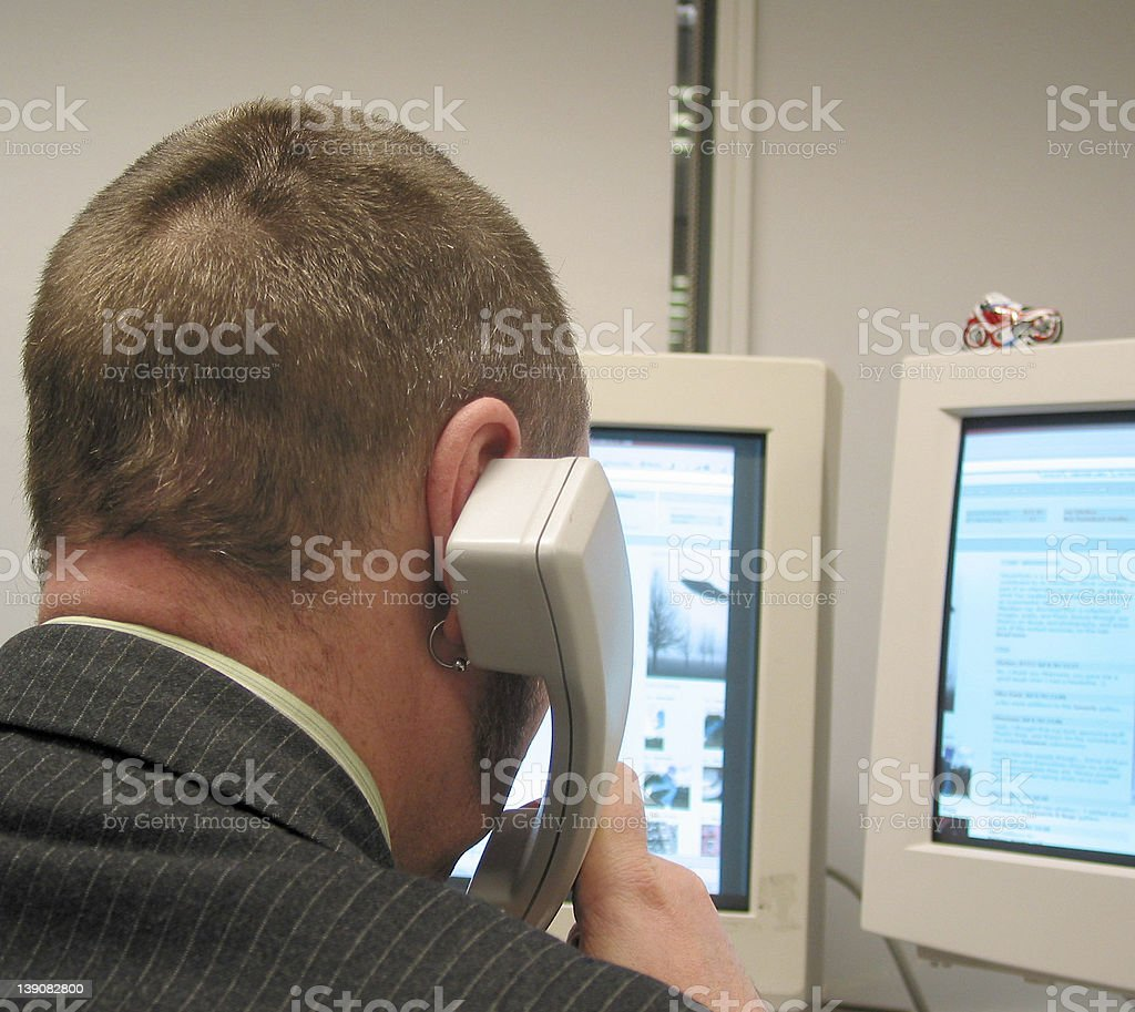 corporate - man on phone advising client stock photo